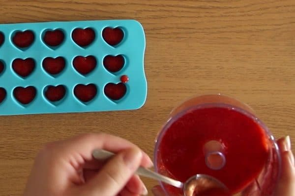 Spoon the strawberry mixture into the ice cube tray