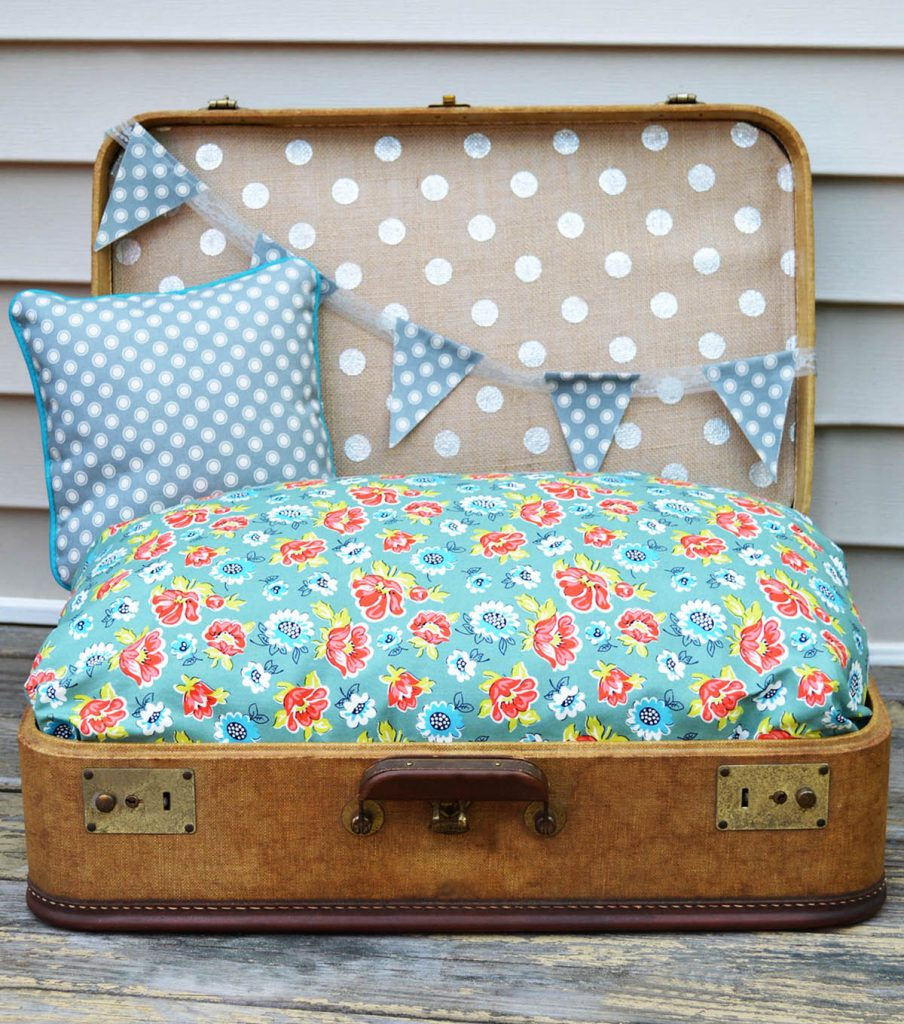 Vintages suitcase dog bed